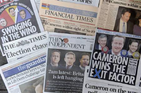 A selection of British newspapers with headlines relating to the general election is displayed in London, May 07, 2010.  REUTERS/Paul Hackett