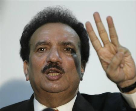 Rehman Malik, Pakistan's adviser to the prime minister on the interior, gestures during a news conference at the interior ministry in Islamabad February 12, 2009. REUTERS/Faisal Mahmood/Files