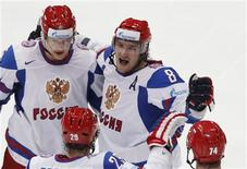 <p>Russia's Alexander Ovechkin (R) celebrates with team mate Ilya Nikulin after scoring a goal against Slovakia during their Ice Hockey World Championships match in Cologne May 9, 2010. REUTERS/Grigory Dukor</p>