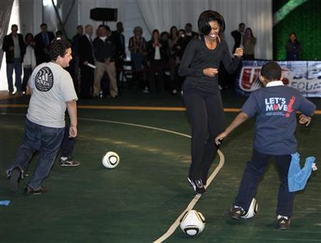 U.S. first lady Michelle Obama plays with children at a soccer clinic in Washington on March 5, 2010. REUTERS/Yuri Gripas