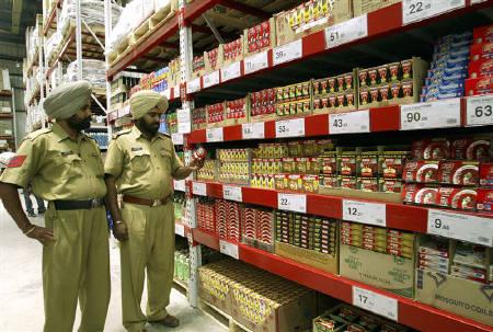 Policemen stand inside a cash-and-carry Wal-Mart store in Amritsar May 30, 2009. Wal-Mart Stores Inc, the world's biggest retailer, will accelerate its rollout of wholesale stores in India, a crucial growth market that has long frustrated overseas operators with restrictive rules. REUTERS/Munish Sharma/Files