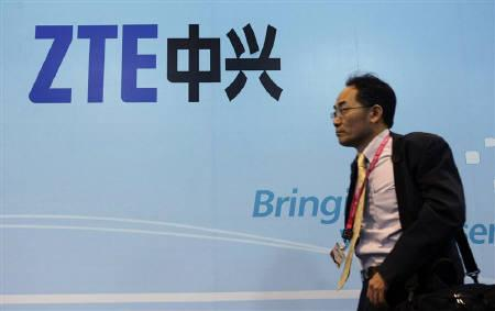 A man walks past a ZTE banner at the Mobile World Congress in Barcelona February 17, 2010. India's concerns that Chinese telecoms network equipment will compromise national security risks hurting ties between the world's two fastest growing economies. REUTERS/Albert Gea/Files