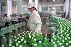 <p>A worker checks the Sprite production line at the Hefei Coca Cola plant. REUTERS/file</p>