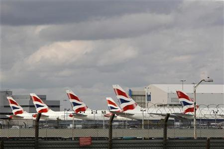 British Airways aircrafts sit parked at Heathrow airport, west of London, March 28, 2010. REUTERS/Suzanne Plunkett