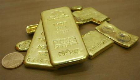 Gold bars are displayed at a gold jewellery shop in Chandigarh November 4, 2009. Gold prices ended unchanged on Tuesday, supported by safe-haven buying due to volatility in the euro market. REUTERS/Ajay Verma/Files