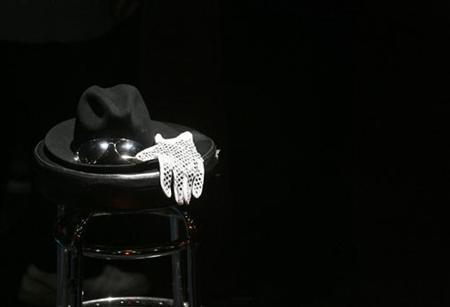 A hat, a pair of glasses and a glove sit on a chair on a stage at the Michael Jackson public memorial at the Apollo Theater in New York June 30, 2009. REUTERS/Lucas Jackson