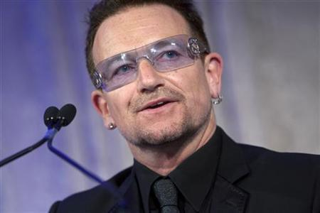 Bono, the lead singer of U2, speaks after being awarded the Distinguished Humanitarian Leadership Award during the Atlantic Council Annual Awards Dinner in Washington, April 28, 2010. REUTERS/Benjamin J. Myers