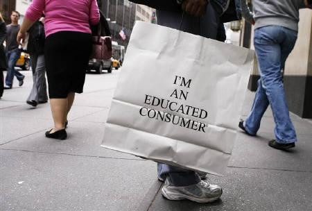 A shopper walks down Fifth Avenue with a shopping bag in New York in this October 8, 2009 file photo. REUTERS/Lucas Jackson/Files