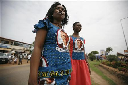 Ghanaian women wearing dresses featuring the likeness of U.S. President Barack Obama walk down the street during Obama's first visit to sub-Saharan Africa, in Ghana's capital Accra in this July 11, 2009 file photo. REUTERS/Finbarr O'Reilly/Files