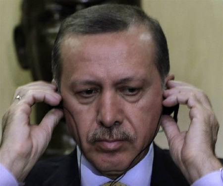 Turkey's Prime Minister Recep Tayyip Erdogan listens to a translation through a headset in Sao Paulo May 26, 2010. REUTERS/Nacho Doce