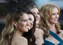"<p>Actresses (From L-R) Sarah Jessica Parker, Kristin Davis, Kim Catrall and Cynthia Nixon pose for photographers at the premiere of their new film ""Sex and the City 2"" in Leicester Square, London May 27, 2010. REUTERS/Kieran Doherty</p>"