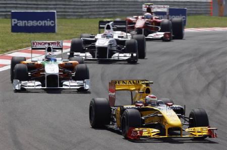 Renault Formula One driver Vitaly Petrov (R) of Russia drives ahead of Force India Formula One driver Adrian Sutil of Germany (L) during the Turkish F1 Grand Prix at the Istanbul Park circuit in Istanbul May 30, 2010.  REUTERS/Murad Sezer