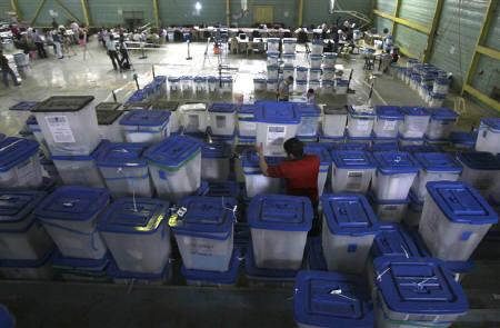 A worker aligns boxes containing parliamentary election ballots at a counting centre in Baghdad March 18, 2010. Iraq's Supreme Court certified the final results of a March 7 parliamentary election on Tuesday, an important step toward the formation of a new government. REUTERS/Saad Shalash/Files