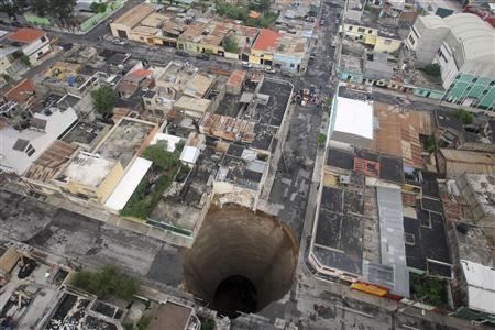 A giant sinkhole caused by the rains of Tropical Storm Agatha is seen in Guatemala City May 31, 2010. REUTERS/Casa Presidencial/Handout