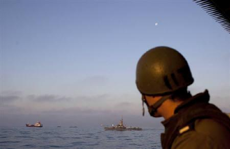 An Israeli soldier stands guard aboard a naval vessel as Gaza-bound ships are intercepted in the Mediterranean Sea May 31, 2010. Russia and the European Union condemned on Tuesday Israel's use of deadly force in the storming of an aid flotilla and urged the opening of crossings into Gaza. REUTERS/Uriel Sinai/Pool
