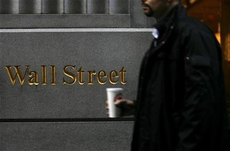 A man passes in front of a sign on Wall Street in New York, February 10, 2009. REUTERS/Eric Thayer