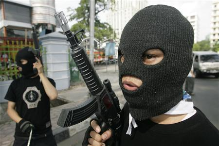 An Indonesian Muslim activist holds a toy gun during a demonstration to protest against Israeli marines' storming of a Turkish aid ship bound for Gaza, in Jakarta June 2, 2010. REUTERS/Tarmizy Harva