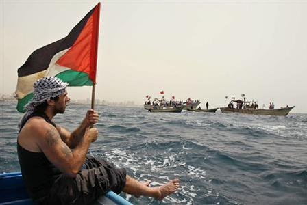 A pro-Palestinian activist rides a boat during a protest at the Gaza Seaport against Israel's interception of of Gaza-bound ships, June 3, 2010. REUTERS/Mohammed Salem