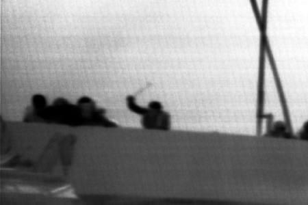 A frame grab from a video released by the Israel Defence Forces (IDF) shows what the IDF says is a pro-Palestinian activist hitting Israeli soldiers with a club-like object upon the arrival of Israeli forces to a Gaza-bound ship May 31, 2010. REUTERS/Handout/IDF
