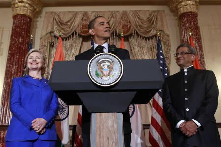 U.S. President Barack Obama speaks at the the U.S.-India Strategic Dialogue reception at the State Department in Washington June 3, 2010. At left is Secretary of State Hillary Clinton and on the right is Indian Foreign Minister S.M. Krishna. REUTERS/Kevin Lamarque