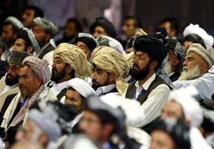Delegates listen to the opening address of the peace jirga by Afghan President Hamid Karzai in Kabul June 2, 2010. REUTERS/Omar Sobhani