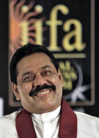Sri Lanka's President Mahinda Rajapakse attends a business forum during the International Indian Film Academy (IIFA) awards in Colombo June 4, 2010. REUTERS/Rupak De Chowdhuri