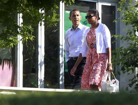 President Barack Obama and first lady Michelle Obama arrive at Sidwell Friends School in Bethesda, MD, June 3, 2010, which their daughter Sasha attends. REUTERS/Jason Reed
