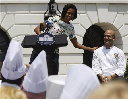 First lady Michelle Obama talks about White House chef Sam Kass at a ''Let's Move!'' chefs event on the South Lawn of the White House in Washington, June 4, 2010. REUTERS/Larry Downing
