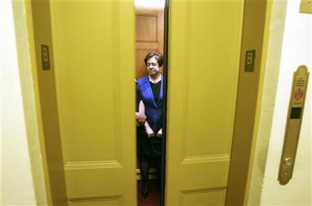 Supreme Court nominee Elena Kagan boards an elevator during her day on Capitol Hill, meeting with various Senators who will vote on her nomination to the U.S. highest court, May 12, 2010. REUTERS/Jason Reed