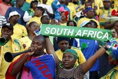 <p>South African supporters cheer their team before the international friendly soccer match against Denmark at the Super Stadium in Pretoria June 5, 2010. The 2010 FIFA Soccer World Cup kicks off on June 11. REUTERS/Siphiwe Sibeko</p>
