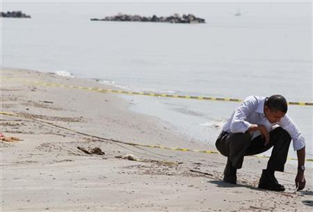 President Barack Obama surveys damage along the Louisiana coastline at Fourchon Beach caused after a BP oil line ruptured in the Gulf of Mexico, May 28, 2010. REUTERS/Larry Downing