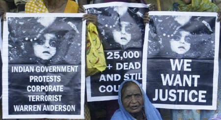 A victim of the Bhopal gas disaster attends a demonstration outside a court in Bhopal June 7, 2010. Activists demanded reforms of justice system and stricter laws for industrial disasters after a court took nearly 26 years to hand down a verdict for the world's worst industrial accident. REUTERS/Raj Patidar