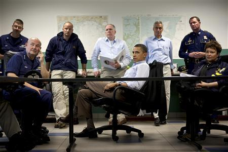 U.S. President Barack Obama (C) listens during a briefing about the situation along the Gulf Coast following the BP oil spill, at the Coast Guard Venice Center, in Venice, Louisiana, in this White House handout photo taken on May 2, 2010 and released on June 7, 2010. Picture taken May 2, 2010. REUTERS/Pete Souza/The White House