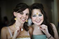 <p>Gaia Damerst (L) and Mallory Evans display their mediport pendants as they prepare for a prom sponsored by The Children's Hospital for cancer patients in Denver June 8, 2010. REUTERS/Rick Wilking</p>