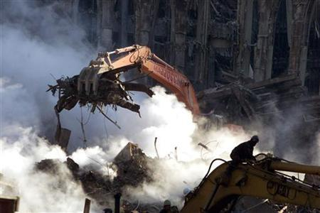 A crane lifts rubble from the ruins of the World Trade Center in New York, October 12, 2001. REUTERS/Brad Rickerby