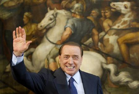 Italian Prime Minister Silvio Berlusconi waves during a meeting with Spanish counterpart Jose Luis Rodriguez Zapatero at Chigi palace in Rome June 10, 2010. REUTERS/Max Rossi