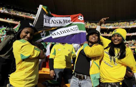 Soccer fans hold up a flag as they give thanks to former South African President Nelson Mandela (also known as Madiba) during the opening ceremony of the 2010 World Cup at Soccer City stadium in Johannesburg June 11, 2010. REUTERS/Kai Pfaffenbach