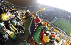 <p>A fan blows the vuvuzela ahead of the 2010 World Cup opening match between South Africa and Mexico at Soccer City stadium in Johannesburg June 11, 2010. REUTERS/Kim Kyung-Hoon</p>