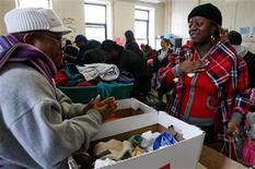 <p>A woman conveys her gratitude to a volunteer distributing free hats and scarves during New York's largest Christmas Day Celebration for New Yorkers in need at the YMCA in Brooklyn, New York December 25, 2009. REUTERS/Jessica Rinaldi</p>