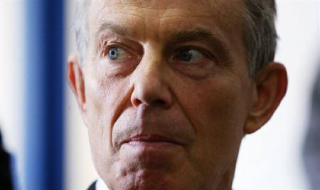 Britain's former prime minister Tony Blair visits the Earcroft Children's Centre in Darwen, Lanchashire May 4, 2010. REUTERS/Dave Thompson/Files