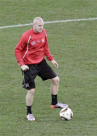 Switzerland's Philippe Senderos warms up during a training session at the Moses Mabhida Stadium in Durban, June 15, 2010. REUTERS/Rogan Ward