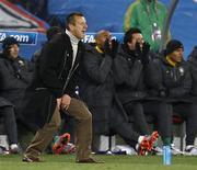 <p>Técnico Dunga reage durante estreia do Brasil contra a Coreia do Norte na Copa da África do Sul: seleção levou susto no fim mas venceu por 2 x 1. REUTERS/Kai Pfaffenbach</p>