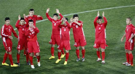 North Korea's players acknowledge the crowd at the end of a 2010 World Cup Group G soccer match against Brazil at Ellis Park stadium in Johannesburg June 15, 2010. REUTERS/Kim Kyung-Hoon