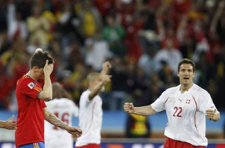 Spain's Fernando Torres (L) reacts next to Switzerland's Mario Eggimann (R) after their 2010 World Cup Group H match at Moses Mabhida stadium in Durban June 16, 2010. REUTERS/Marcelo Del Pozo