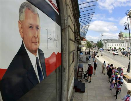 An election poster of Jaroslaw Kaczynski, presidential candidate of Poland's Law and Justice Party (PiS) and twin brother of the late president Lech Kaczynski, is seen in a window of the PiS election headquarters in Warsaw June 16, 2010. REUTERS/Peter Andrews