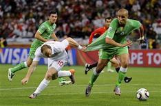 <p>Lance do jogo entre Inglaterra e Argélia, que empataram em 0 x 0 na Copa. REUTERS/Dylan Martinez</p>