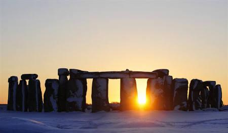 The sun sets behind Stonehenge in Wiltshire, southern England January 7, 2010. REUTERS/Kieran Doherty/Files