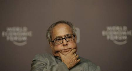 Finance Minister Pranab Mukherjee is seen at the World Economic Forum in New Delhi in this November 10, 2009 file photo. Mukherjee said on Tuesday he will not challenge the International Monetary Fund's prediction that India's economy will grow 8.8 percent this year, despite his ministry's own forecast of 8.5 percent growth. REUTERS/B Mathur/Files