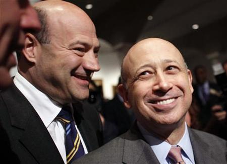 Goldman Sachs CEO Lloyd Blankfein (R) and his colleague Gary Cohn (L), president and COO, attend a speech by U.S. President Barack Obama about new financial regulation at Cooper Union in New York April 22, 2010. REUTERS/Natalie Behring