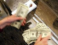 <p>Four thousand U.S. dollars are counted out by a banker counting currency at a bank in Westminster, Colorado November 3, 2009. REUTERS/Rick Wilking</p>